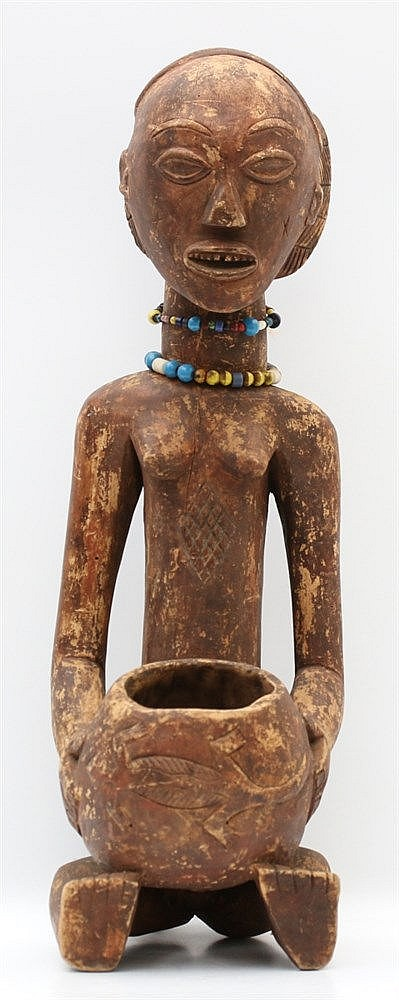 A wooden Mboko figure with two beaded necklaces, Luba tribe, Zai