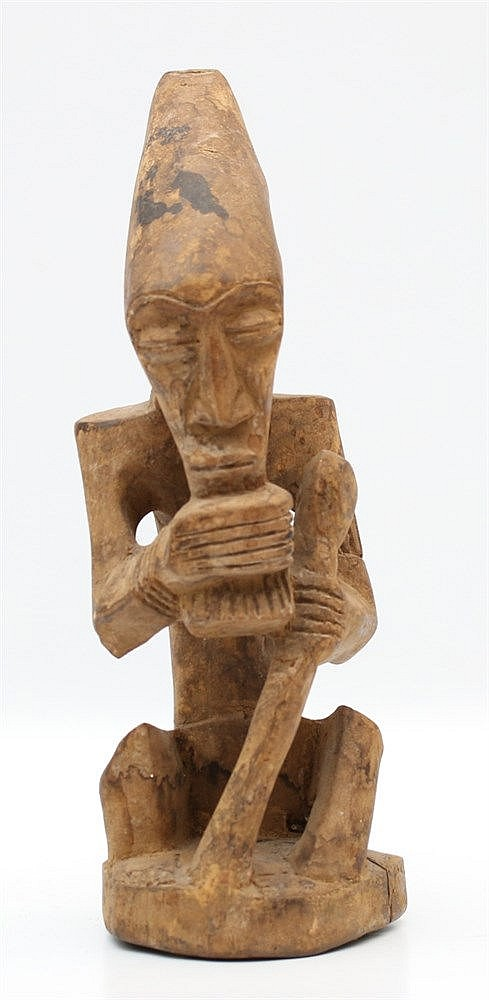 An African wooden sculpture of a man with beard and elongated he