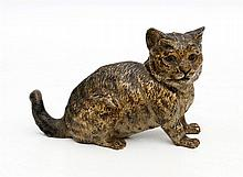 A Viennese bronze sculpture of a sitting cat.  Hoogte 6 cm.