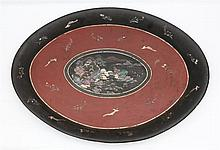 An oval lacquered tin tray. Inlaid with mother of pearl. Chinese