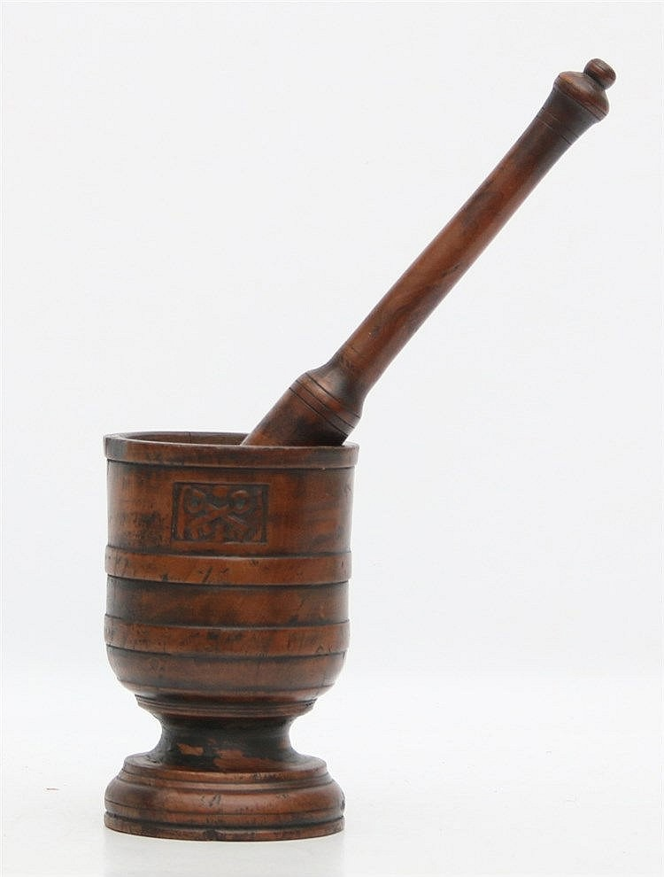 A walnut pestle and mortar. Marked with crossed keys, the city a