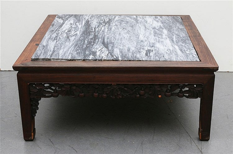 A Chinese wood low table, the sides carved with vine and double