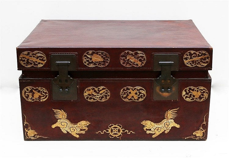 A dark-red lacquered chest with gilt applications of buddhist sy