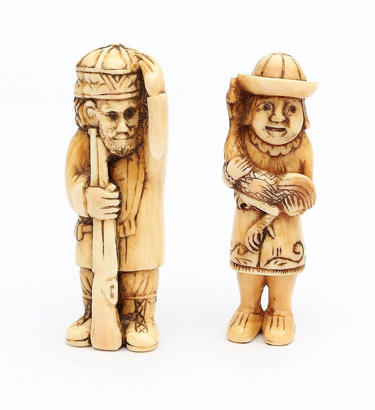 Two Japanese ivory netsuke, each carved as a Dutchman, one holdi