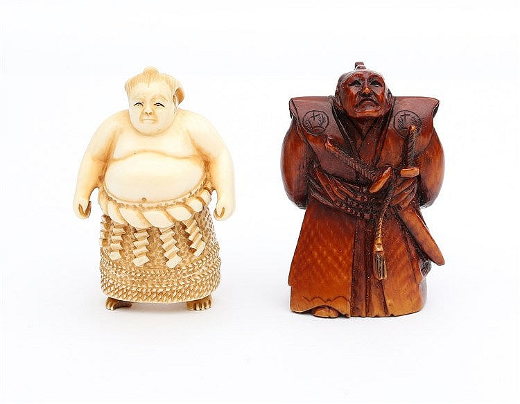 Two Japanese ivory netsuke, one carved as a samurai, the other a