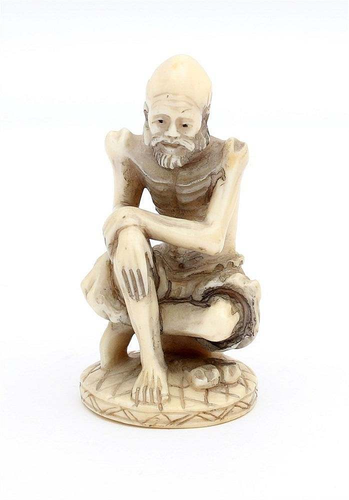 A Japanese ivory netsuke carved as a Sennin. Signed, 19th centur