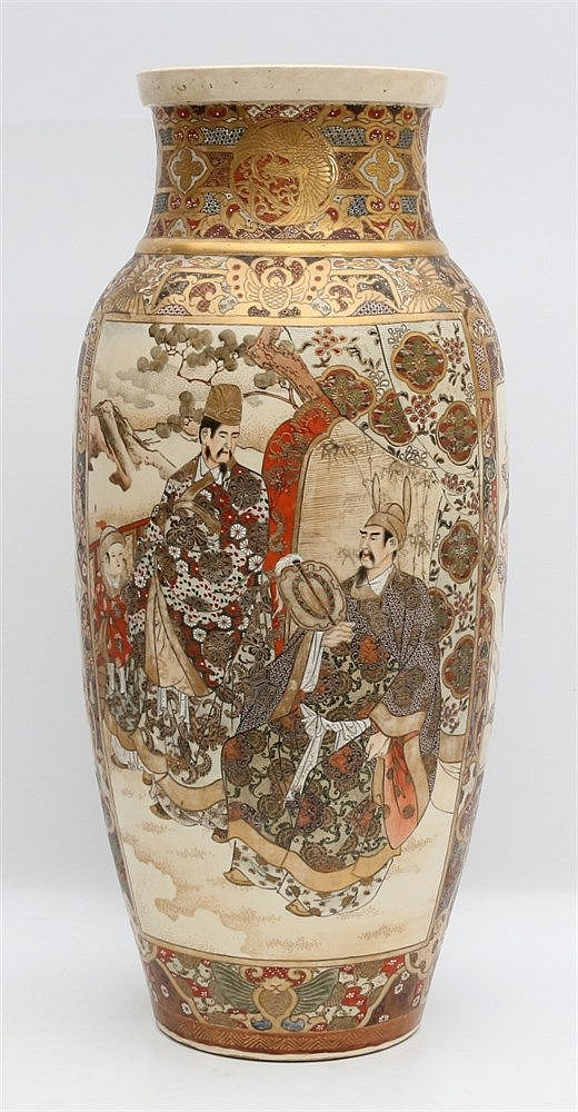 A Japanese Satsuma vase decorated with figures in dressed in kim