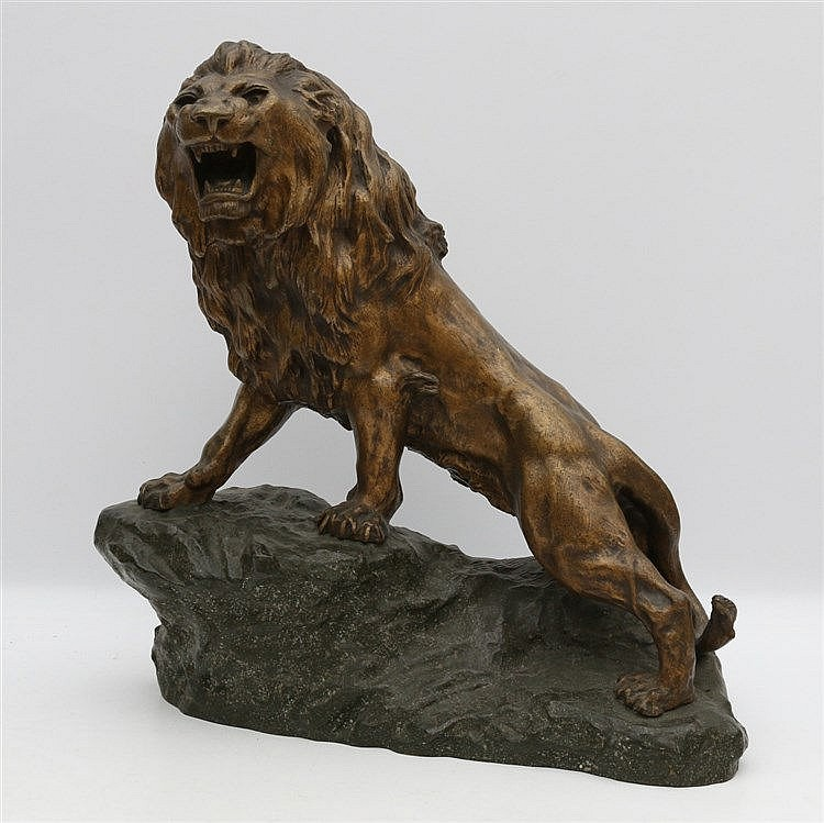 Thomas François Cartier (1879-1943) A bronze sculpture. A roaring