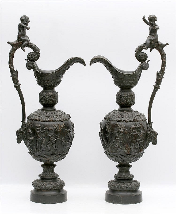 A pair of bronze ewers. Each with a cherubs. Unsigned. 19th cent