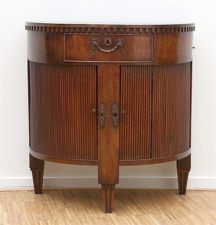 A semi-circular mahogany cabinet, with two drawers. 19th century