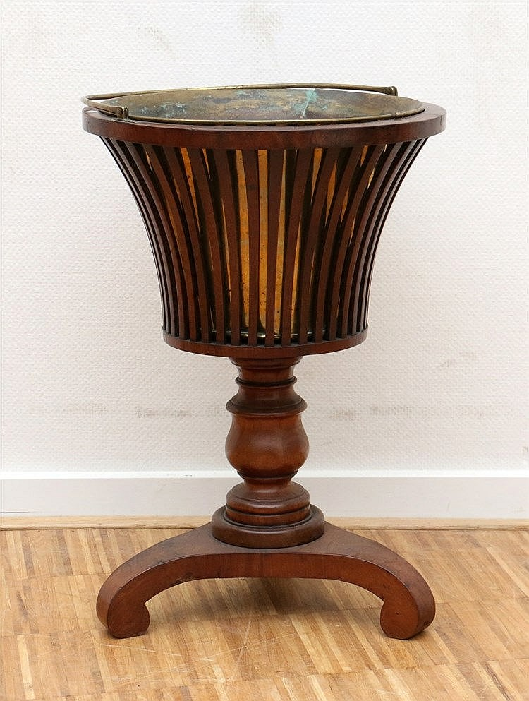 A mahogany jardinière on three-legged foot, with copper liner. 1