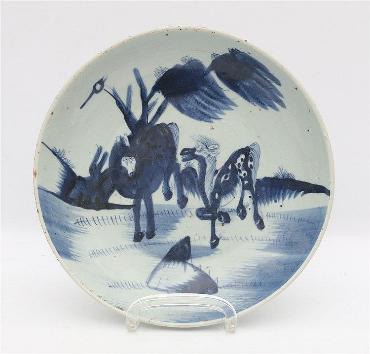 A Chinese blue and white dish decorated with two horses. Late Mi