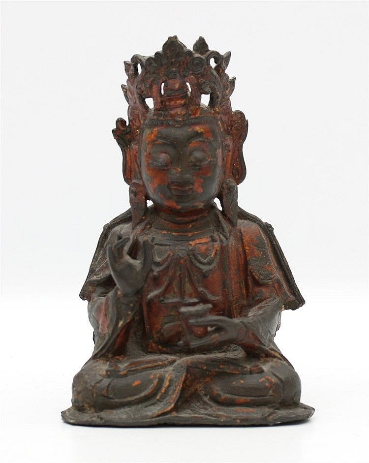 A Chinese lacquered bronze figure of Guanyin, seated in dhyana