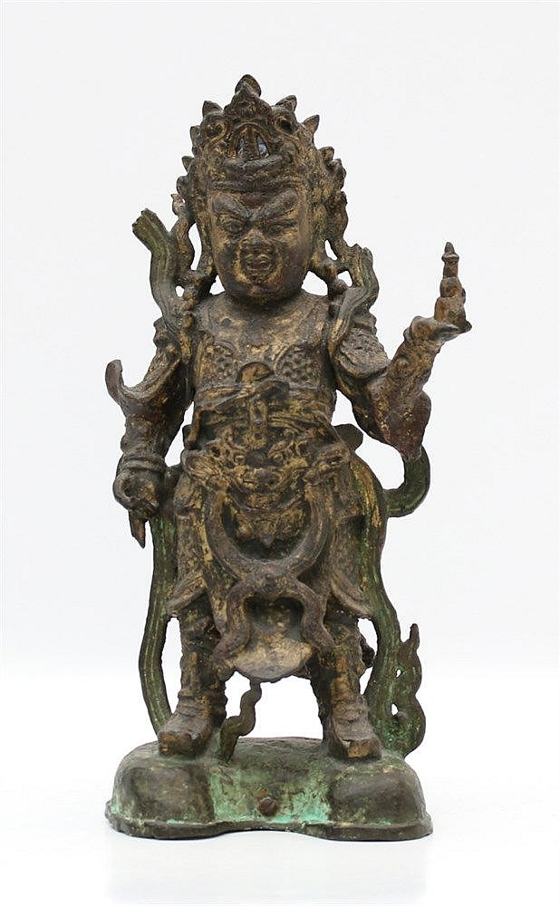A Chinese bronze figure of Lokapala Vaishravana, dressed in ela