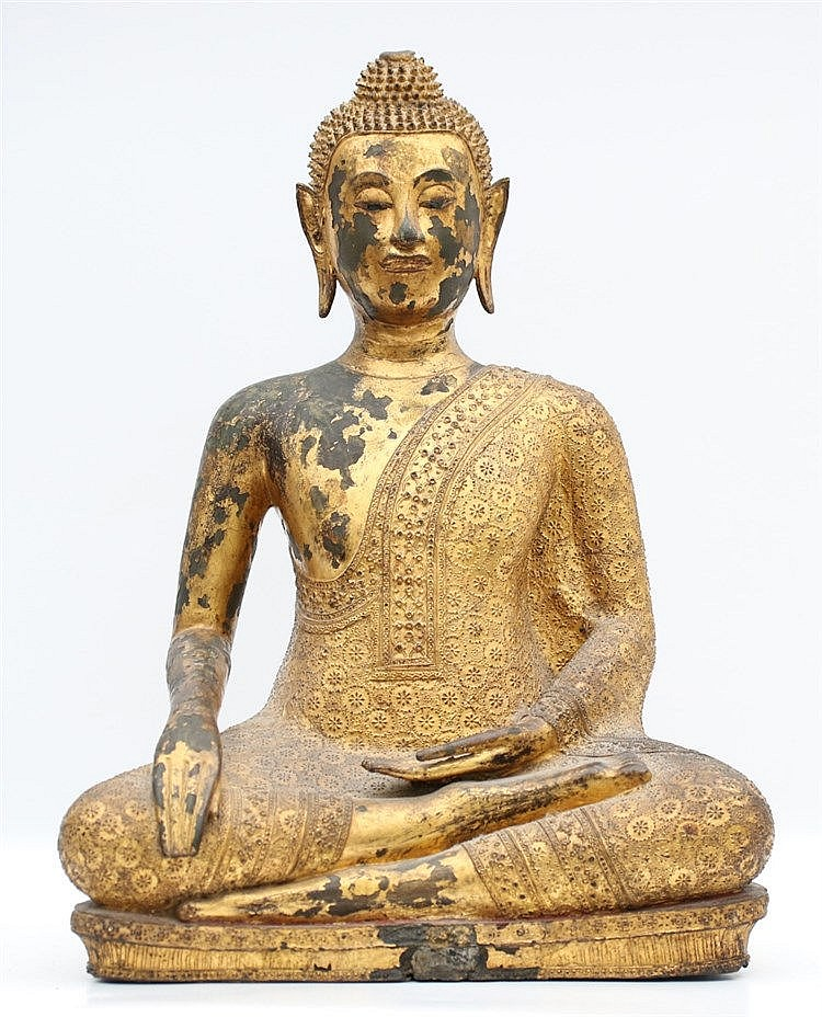A Thai Ratnakosin style gilt bronze seated Buddha, his left han