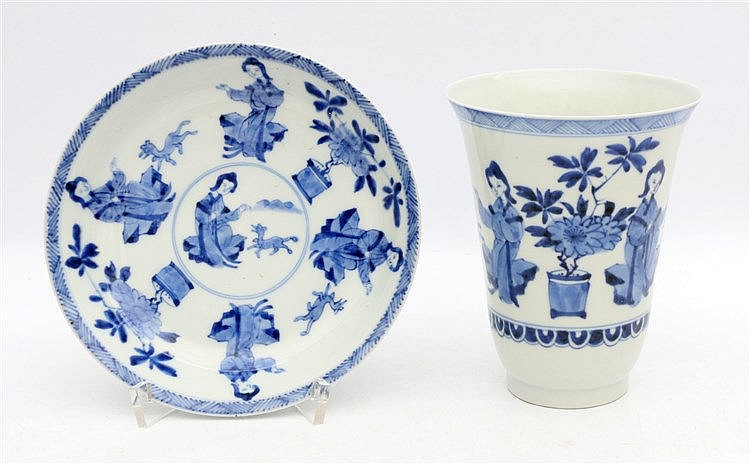 A Chinese blue and white saucer decorated with ladies and small