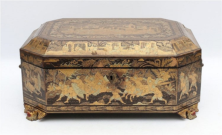 A Chinese export octagonal lacquer box on four monster-head feet