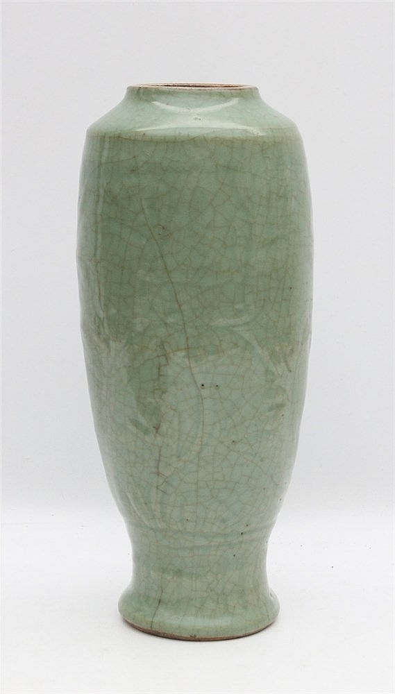 A Chinese celadon vase carved with a flowing floral pattern and