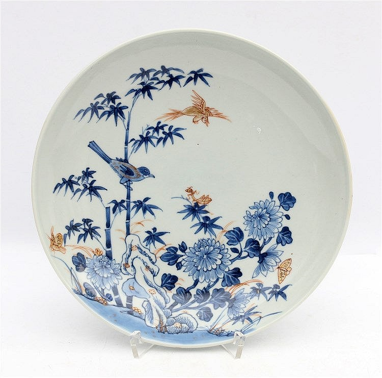 A Chinese Imari plate decorated with birds and insects in a gard