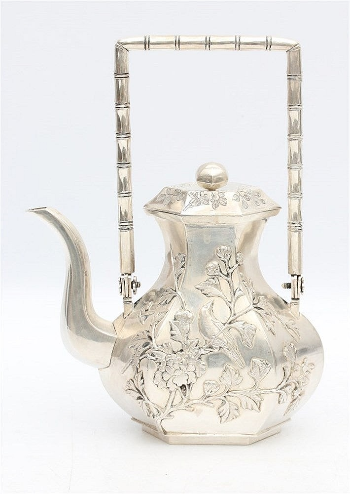 A Chinese hexagonal silver teapot and cover, decorated with a bi
