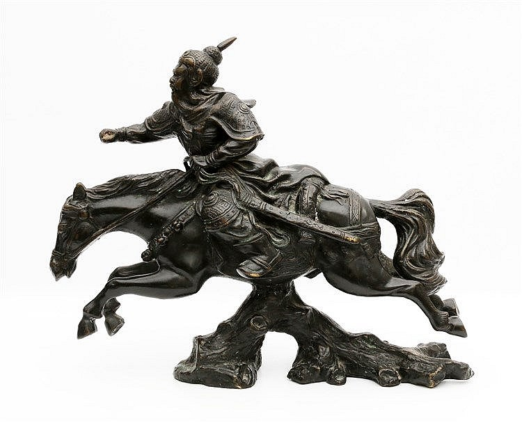 A Japanese bronze sculpture of a samurai warrior on horseback. 2