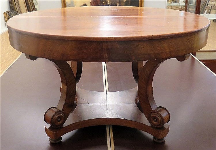 A mahogany dining table, with one original extra leaf and a late