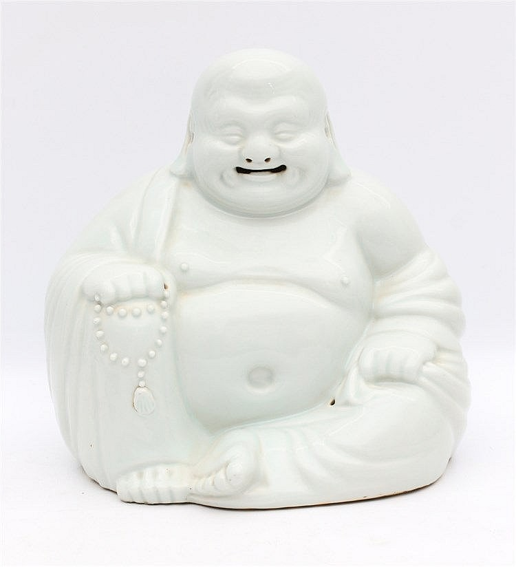 A Chinese white-glazed figure of Budai with a string of beads in