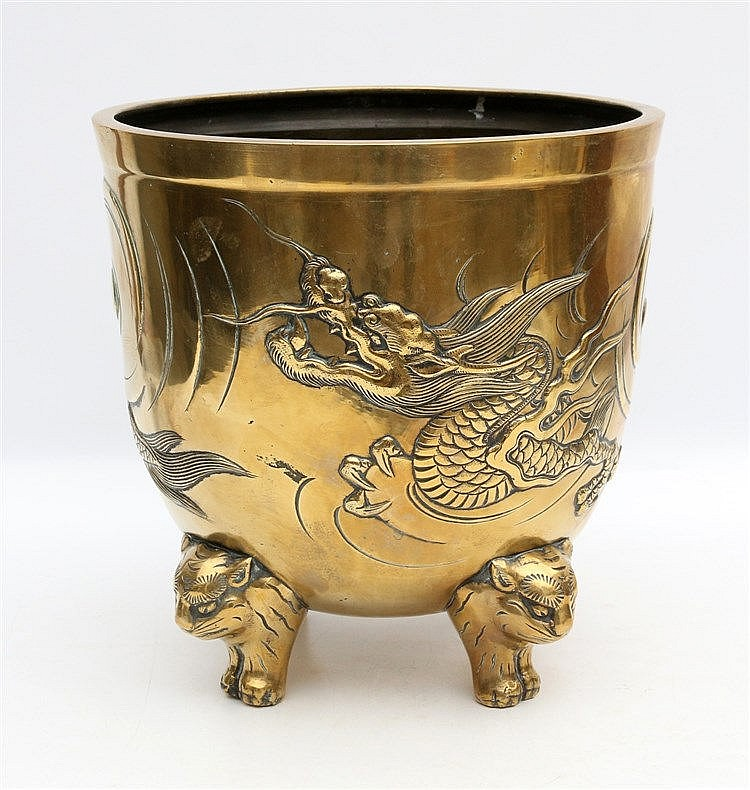 A Japanese gilt-bronze censer cast with a dragon, on three lion-