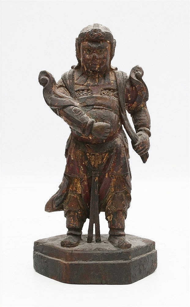 A Chinese lacquered wood figure of a Lokapala, dressed in full a