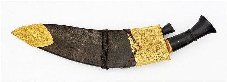 A royal Khotimora Kukri. The leather scabbard with gold mounts,
