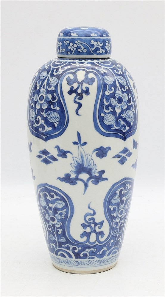 A Chinese blue and white vase and cover, decorated with shaped c
