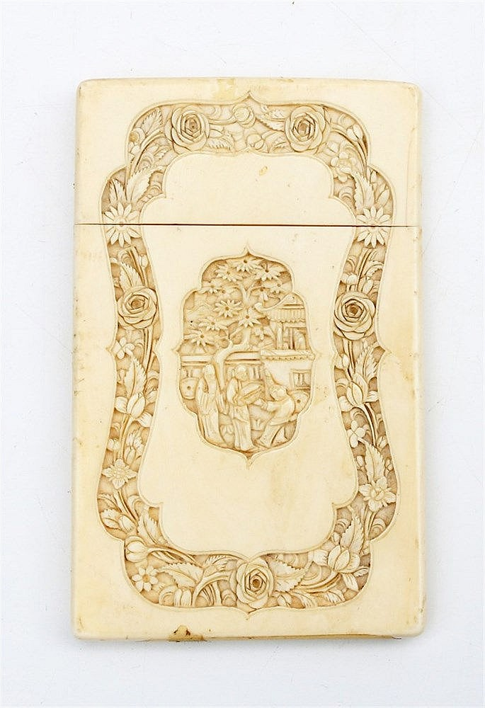 A Chinese Cantonese ivory card holder, carved with cartouches of