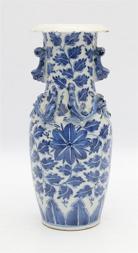 A Chinese blue and white vase decorated with flowers, the shoul