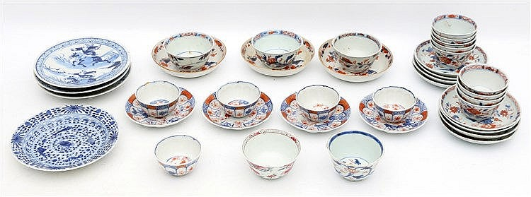 A collection of Chinese and Japanese Imari cups and saucers, com
