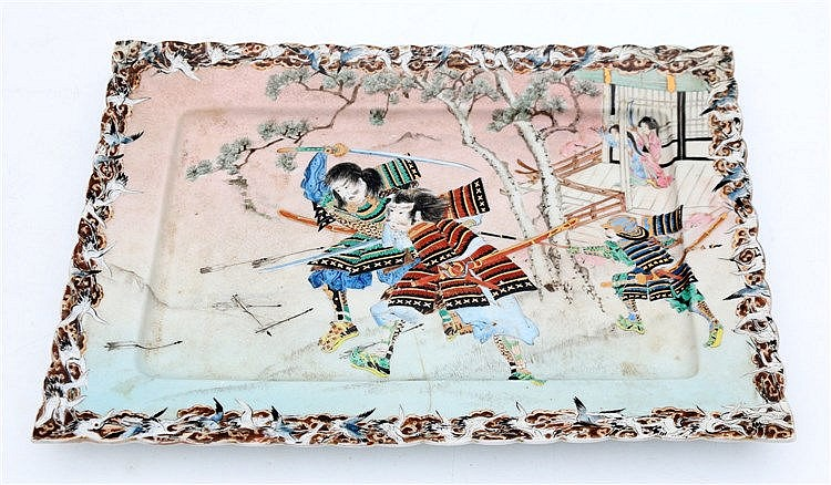A Japanese rectangular kutani dish decorated with samurai before