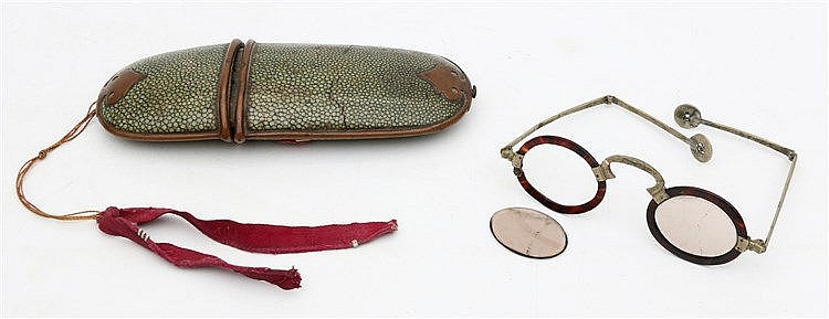 A Japanese shagreen oval spectacle case with copper mounts and c