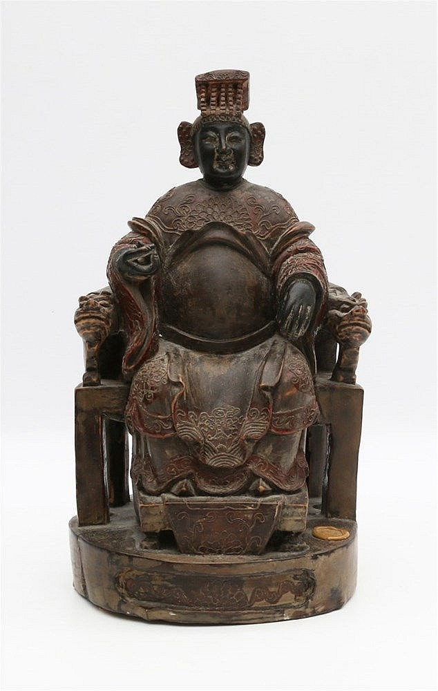 A Chinese carved wood figure of a divinity or an ancestor, seate
