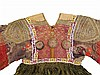 A traditional Asian dress, with pleated silk skirt and embroider