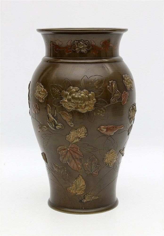 A Japanese bronze vase, decorated in relief with birds amongst p