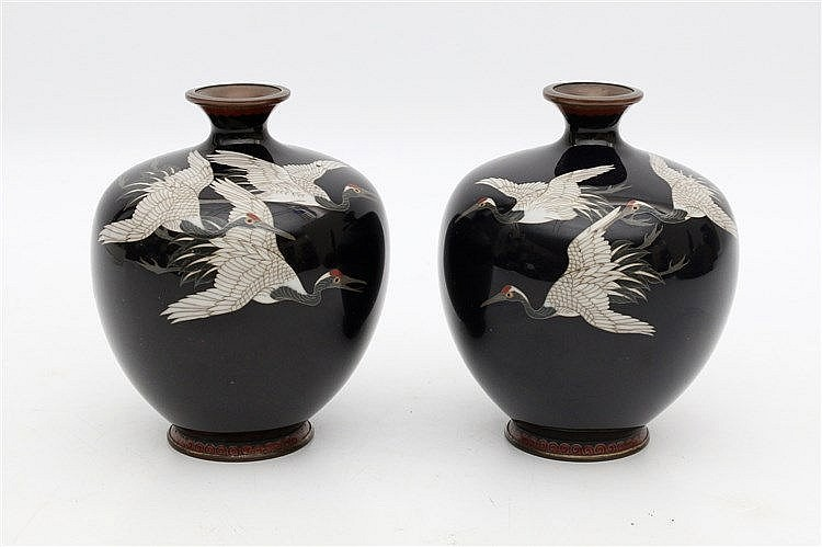 A pair of Japanese vases, inlaid with cranes on a midnight blue