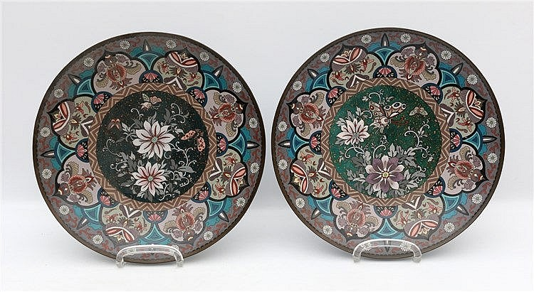 A pair of Japanese cloisonne dishes inlaid with flowers and phoe