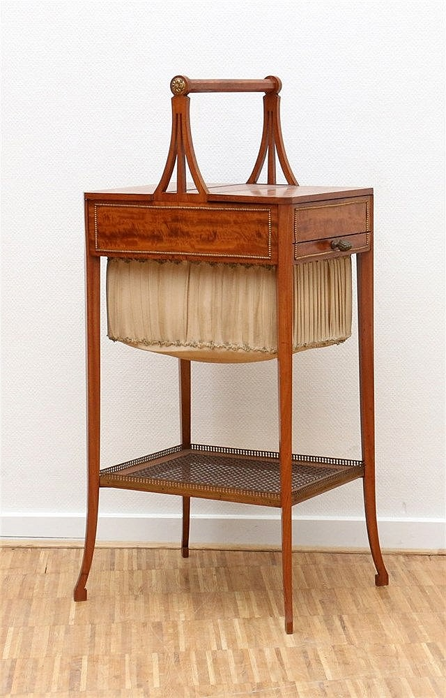 A Charles X cherry wood sewing table, 19th century. Hoogte 87,