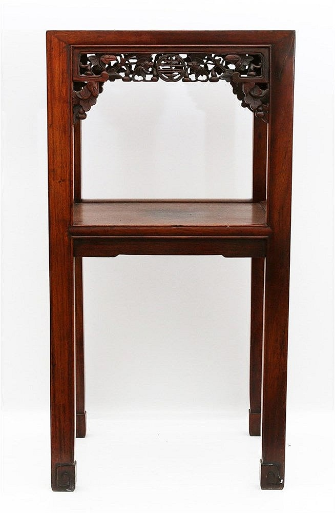A Chinese wood side-table, the sides carved with a shou -symbol