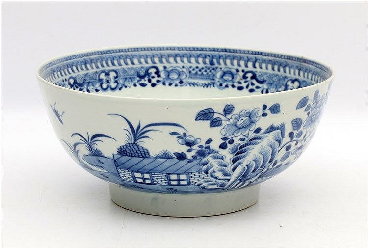A Chinese blue and white bowl decorated with butterflies in a ga