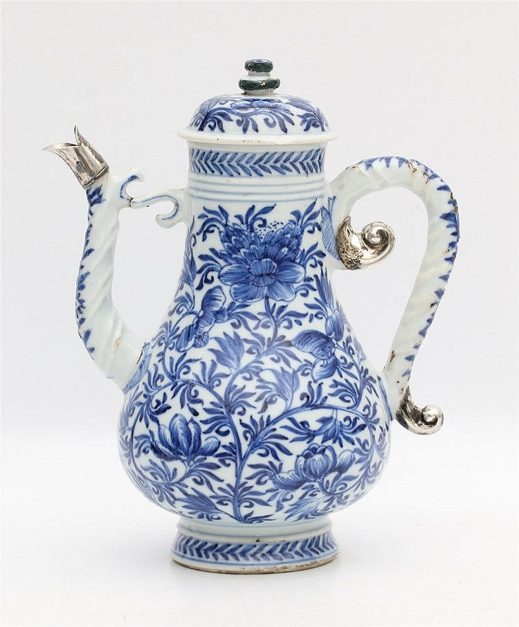 A Chinese blue and white ewer decorated with floral branches, mo