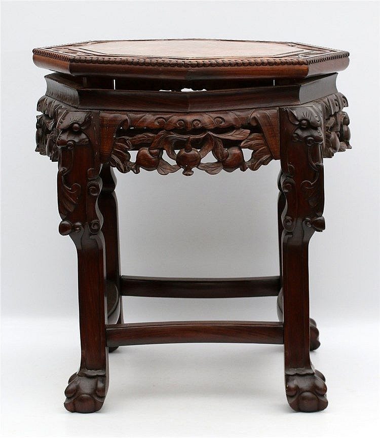 A Chinese hardwood side-table on four claw feet, the sides openw