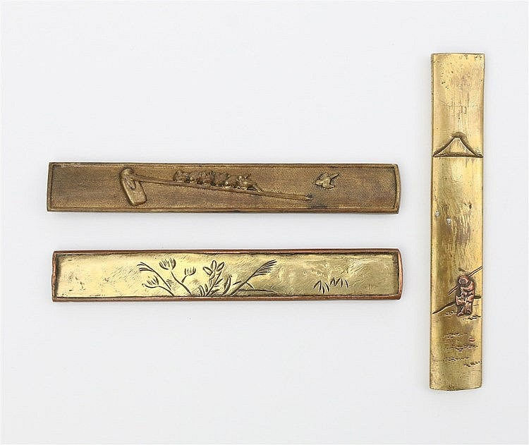 A copper kozuka, both sides with relief decoration of birds on