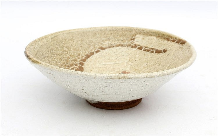 A Japanese earthenware shino -style glazed chawan bowl. 19th