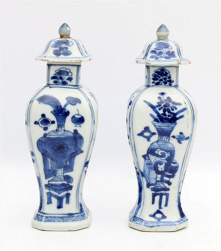 A pair of Chinese blue and white square balustervases and cover