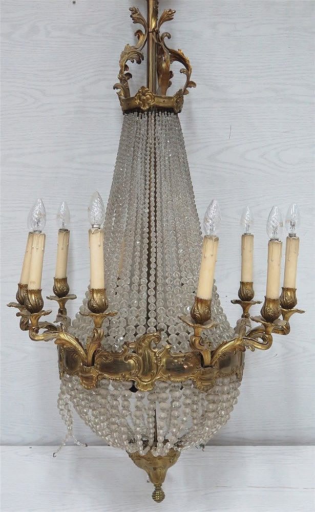 A crystal chandelier mounted with gilt bronze elements. First ha